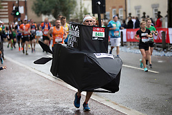 © Licensed to London News Pictures. 03/10/2021. London, UK. A runners in fancy dress passes through Greenwich as they take part in the 2021 London Marathon.This London Marathon will be the first full scale staging of the race in more than two years due to the Coronavirus Pandemic.  Photo credit: George Cracknell Wright/LNP