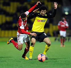 Watford's Iriney fouls Bristol City's Bobby Reid - Photo mandatory by-line: Dougie Allward/JMP - Tel: Mobile: 07966 386802 14/01/2014 - SPORT - FOOTBALL - Vicarage Road - Watford - Watford v Bristol City - FA Cup - Third Round - replay