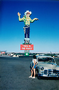 """CS00483-03. """"This is the Place"""" sign Wendover, Nevada, on Utah – Nevada border. July 1954."""