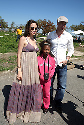 16 March 2008. New Orleans, Louisiana. Lower 9th ward.<br /> Movie stars Brad Pitt and Angelina Jolie pose with resident local resident Dee Carla Rogers (9 yrs). They were in town with Former President Bill Clinton and 600 volunteers for the 'Make a Difference, Make a Commitment' clean up of the neighbourhood devastated by Hurricane Katrina. The massive clean up project was organised by Brad Pitt's Make it Right Foundation aided by the Clinton Global Initiative.<br /> Photo credit; Charlie Varley.