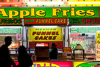 Couple Deciding on What Junk Food to Order, L.A. County Fair, California