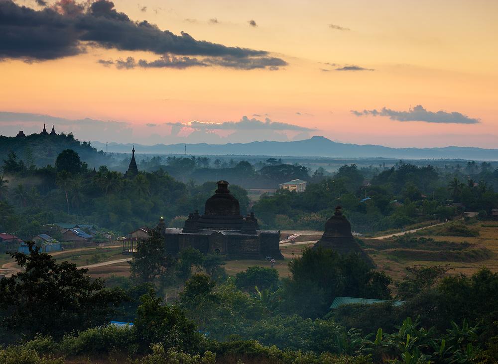MRAUK U, MYANMAR - CIRCA DECEMBER 2017: Sunset over the hills of Mrauk U in Myanmar