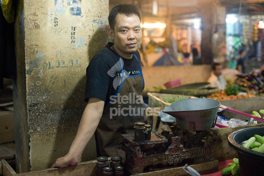 Picture by Daniel Hambury. .6/2/11..A local trader in the main market in Cianjur, Indonesia.