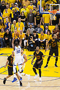Golden State Warriors forward Kevin Durant (35) shoots a three pointer against the Cleveland Cavaliers during Game 5 of the NBA Finals at Oracle Arena in Oakland, Calif., on June 12, 2017. (Stan Olszewski/Special to S.F. Examiner)