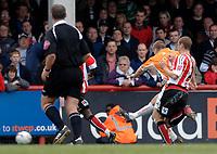Photo: Daniel Hambury.<br />Brentford v Blackpool. Coca Cola League 1. 17/04/2006.<br />Blackpool's Peter Clarke scores to make it 1-1.
