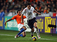 Photo: Paul Thomas.<br /> Holland v England. International Friendly. 15/11/2006.<br /> <br /> Frank Lampard of England (R) gets tackled by Denny Landzaat.