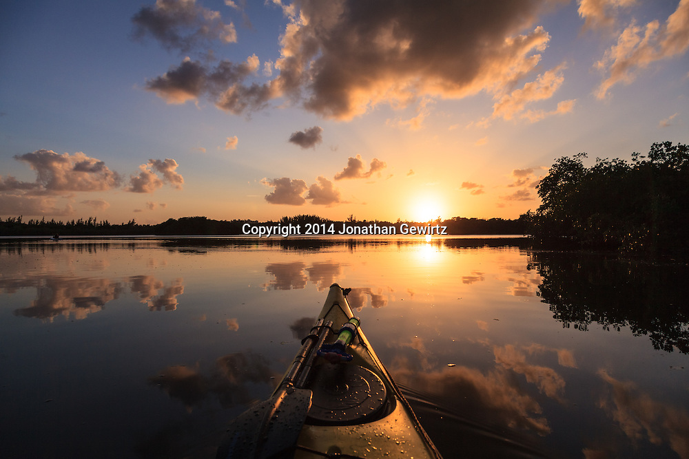 A beautiful sunset as seen from a kayak floating in Hidden Lake near the western shore of Biscayne Bay in Miami, Florida.<br /> WATERMARKS WILL NOT APPEAR ON PRINTS OR LICENSED IMAGES.