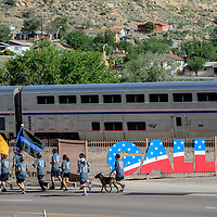 052915       Adron Gardner<br /> <br /> The Amtrak passes through town as Gallup police jog Historic Highway 66 during the Gallup Police Department Fallen Officer's Memorial in Gallup Friday.
