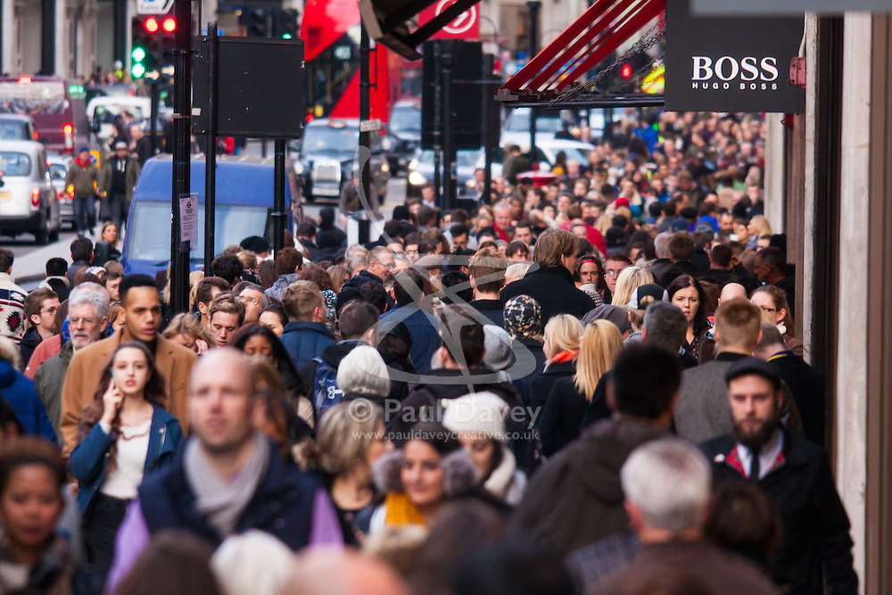 """London, December 23rd 2014. Dubbed by retailers as the """"Golden Hour"""" thousands of shoppers use their lunch hour to do some last minute Christmas shopping in London's West End. PICTURED: Thousands of shoppers cram up-market Regent Street."""