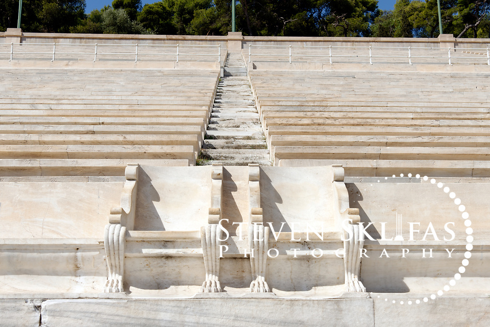 Panathenaic stadium. Athens. Greece. View of the Royal boxes (seats) from 1908 located on the Middle West side of the stadium. The Panathenaic (Kallimarmaro) stadium was used for the first international Olympic games of the modern era in 1896.  The completely marble stadium occupies the exact site of the original, built in 330BC which was used for the ancient Panathenaic games (part of the larger religious festival, the Panathenaia).