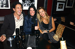 Left to right, jeweller STEPHEN WEBSTER, artist SUE WEBSTER and ASSIA WEBSTER at a Black, White and Gold party to celebrate the December 'Party' issue of Harper's Bazaar featuring the 'Going Out' Guide in association with Moet & Chandon  held at Ronnie Scotts, 47 Frith Street, London on 16th November 2006.<br /><br />NON EXCLUSIVE - WORLD RIGHTS