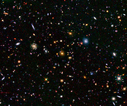 This image shows one of the most distant galaxies known, called GN-108036, dating back to 750 million years after the Big Bang.