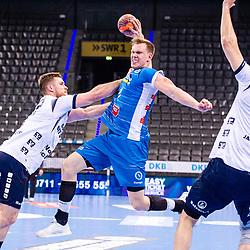 Adam Loenn (TVB Stuttgart #11) ; li:  Johannes Golla (SG Flensburg-Handewitt #4) ; re: Magnus Abelvik Rod (SG Flensburg-Handewitt #77) ; LIQUI MOLY HBL / 1. Handball-Bundesliga: TVB Stuttgart - SG Flensburg-Handewitt am 09.06.2021 in Stuttgart (PORSCHE Arena), Baden-Wuerttemberg, Deutschland<br /> <br /> Foto © PIX-Sportfotos *** Foto ist honorarpflichtig! *** Auf Anfrage in hoeherer Qualitaet/Aufloesung. Belegexemplar erbeten. Veroeffentlichung ausschliesslich fuer journalistisch-publizistische Zwecke. For editorial use only.