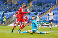 Crawley Town's George Francomb goes past Bolton Wanderers goalkeeper Matthew Gilks(13) during the EFL Sky Bet League 2 match between Bolton Wanderers and Crawley Town at the University of  Bolton Stadium, Bolton, England on 2 January 2021.