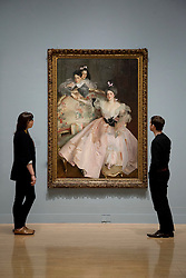 © Licensed to London News Pictures. 30/01/2012. London, UK. Gallery staff look at John Singer Sargent's 'Mrs Carl Meyer and her Children'  at a new Tate Exhibition entitled Migrations: Journeys into British Art. The Exhibition explores how British art has been influenced by migration and includes work by van Dyck, Whistler, Mondrian and Steve McQueen. Photo credit: Matt Cetti-Roberts/LNP
