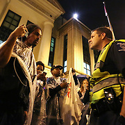 Charlotte, NC- November 30, 2016: CMPD Capt. Mike Campagna talks to Braxton Winston during a demonstration outside poice headquarters.  (CREDIT: Logan Cyrus)