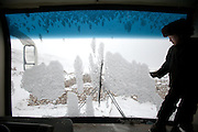 A boy named Karzai plays around the driver's compartment of the only bus in the Pamir, which has been abandoned for years..Failed aid examples in the Pamir abounds, but this is one of the most stricking: A Medical Unit Bus bus brought, with special authorisation, from the Tajikistan side in summer 2007 (an Afghan-Pakistan project) to provide medical help. After a month, the ?doctor? left back to Tajikistan. Since then, the bus is rotting away beside the Khan's camp..Inside there is expired medicine thrown all over the floor...At the Qyzyl Qorum camp. It is the camp of the now deceased Khan (Abdul Rashid Khan, died in December 2009), and headed by the self proclaimed young Haji Roshan Khan (his son). Opium addicted Haji Roshan was never officially stated Khan and is therefore not accepted as leader by the entire Kyrgyz community. Near the Afghan-China border...Trekking through the high altitude plateau of the Little Pamir mountains, where the Afghan Kyrgyz community live all year, on the borders of China, Tajikistan and Pakistan.