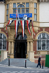 LOCATION, UK  29/04/2011. The Royal Wedding of HRH Prince William to Kate Middleton. .Bunting and a cardboard cut out of the happy couple adourns the balcony of the Town Hall in Marlborough where Kate Middleton went to college...Photo credit should read Ian Forsyth/LNP. Please see special instructions. © under license to London News Pictures
