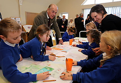 The Duke of Edinburgh speaks with pupils from Burnham Market Primary School, during a visit to officially open the South Creake Memorial Pavillion in Norfolk.