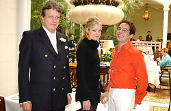 Left to right, LORD VALENTINE CECIL, LADY ELOISE ANSON and jewellery designer LUIS MIGUEL HOWARD at a fashion show of Sybil Stanislaus Summer 2005 collection with jewellery by Philippa Holland held at The Lanesborough Hotel, Hyde Park Corner, London on 13th April 2005.<br /><br />NON EXCLUSIVE - WORLD RIGHTS
