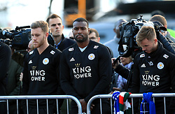 Leicester City's Wes Morgan (centre) pays respect to club chairman Vichai Srivaddhanaprabha, who was among those to have tragically lost their lives on Saturday evening when a helicopter carrying him and four other people crashed outside King Power Stadium.