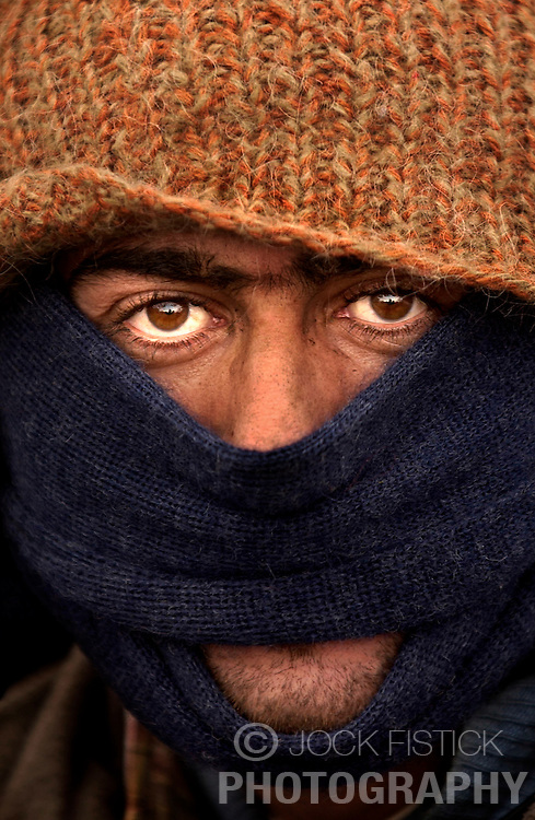 An Iraqi refugee endures sub-freezing temperatures as he is forced to live on the streets after the closing of the Sangatte refugee camp near Calais, France. (Photo © Jock Fistick)