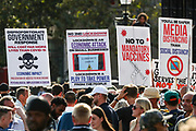 """People hold placards during a """"Resist and Act for Freedom"""" protest against a mandatory coronavirus vaccine, wearing masks, social distancing and a second lockdown, nearby Canada House in Trafalgar Square, London on Saturday, Sept. 19, 2020. The event, which began at noon, drew a broad coalition including coronavirus sceptics, 5G conspiracy theorists and so-called """"anti-vaxxers"""". Speakers at the event accused the government of attempting to curtail civil liberties. (VXP Photo/ Vudi Xhymshiti)"""