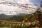 Buddhist prayer flags waving on the banks of the Beas River at Manali, Himachal Pradesh, India