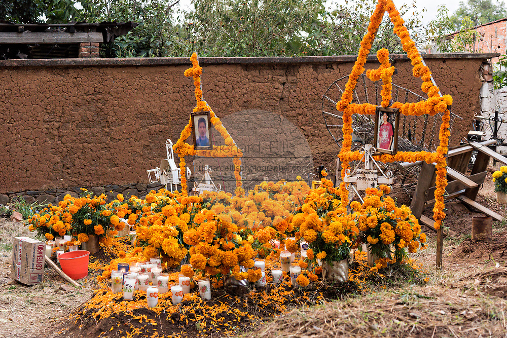 A gravesite decorated with marigolds, candles and offerings for the Day of the Dead festival October 31, 2017 in Tzintzuntzan, Michoacan, Mexico.