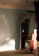 Old fashioned stereo beneath canopy in empty room, El Djem, Tunisia