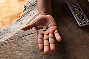 A miner holds gold in his hand, with the sale of the gold he will obtain payment for his 24-hour workday in San José de Kareme, Peru.
