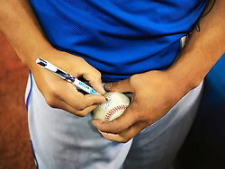 April 28, 2018 - Toronto, ON, U.S. - TORONTO, ON - APRIL 29: Texas Rangers Second base Rougned Odor (12) (currently on the DL) signs a ball for a Venezuelan fan before the MLB game between the Texas Rangers and the Toronto Blue Jays on April 29, 2018 at Rogers Centre in Toronto, ON. (Photo by Jeff Chevrier/Icon Sportswire) (Credit Image: © Jeff Chevrier/Icon SMI via ZUMA Press)