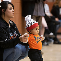 Daniella Trujillo and her son Keanu Trujillo watch the Gallup Bengals dance team perform during halftime of the varsity boys Gallup-Chaparral basketball game at Gallup High School Saturday night in Gallup.