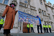 A group of protesters wearing face protective masks hold placards opposing the expansion of Heathrow Airport outside Supreme Court, in central London on Wednesday, Dec 16, 2020.<br /> The supreme court has overturned a February judgment that the third runway at Heathrow airport was illegal. It means the project can now seek planning permission, but the ultimate completion of the runway remains uncertain. (VXP Photo/ Joao Daniel Pereira)