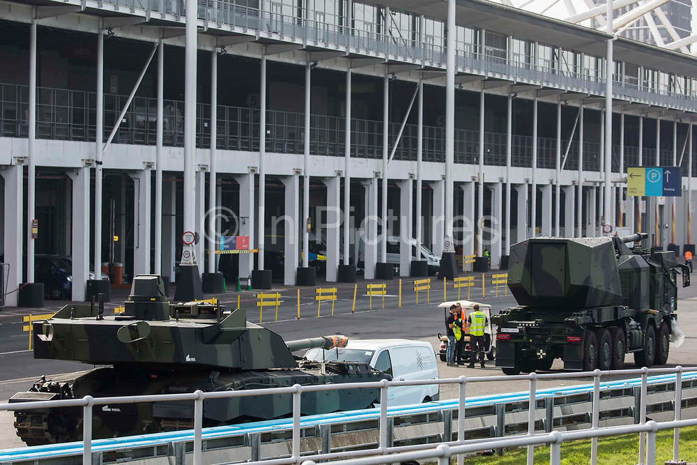 Armed military vehicles are pictured in a holding area outside ExCeL London as preparations for the DSEI 2021 arms fair take place on 6th September 2021 in London, United Kingdom. The first day of week-long Stop The Arms Fair protests outside the venue for one of the worlds largest arms fairs was hosted by activists calling for a ban on UK arms exports to Israel.