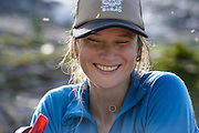 Lorraine Campbell laughs off a mosquito attack in Boston Basin while approaching the Torment-Forbidden Traverse in North Cascades National Park, Washington.