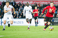 Football - 2016 / 2017 Premier League - Swansea City vs. Manchester United<br /> <br />  Wayne Rooney, captain, of Manchester Utd attacks, chased by Angel Rangel of Swansea at the Liberty Stadium.<br /> <br /> COLORSPORT/WINSTON BYNORTH