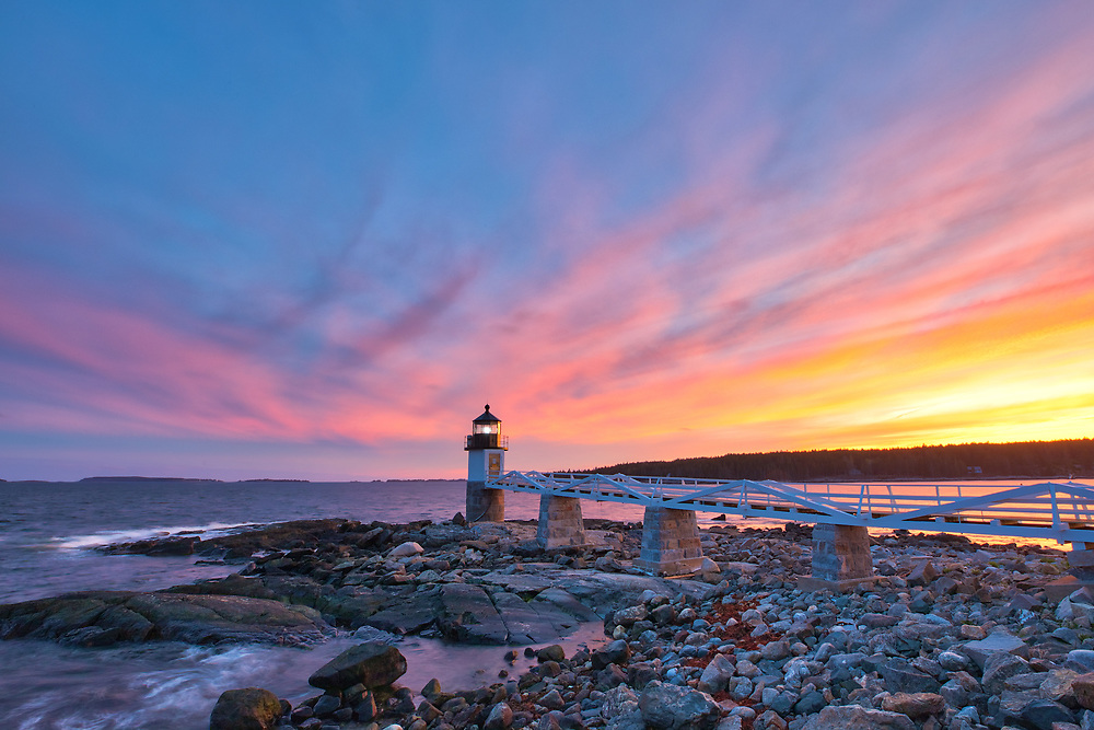 New England photography of Marshall Point Light with its iconic wooden walkway. This beautiful New England lighthouse is located Port Clyde in Maine and marks the entrance to Port Clyde harbor.<br /> <br /> This picturesque Maine lighthouse photography image is available as museum quality photography prints, canvas prints, acrylic prints, wood prints or metal prints. Fine art prints may be framed and matted to the individual liking and interior design decorating needs:<br /> <br /> https://juergen-roth.pixels.com/featured/marshall-point-light-juergen-roth.html<br /> <br /> Good light and happy photo making!<br /> <br /> My best,<br /> <br /> Juergen<br /> Photo Prints: http://www.rothgalleries.com<br /> Photo Blog: http://whereintheworldisjuergen.blogspot.com<br /> Instagram: https://www.instagram.com/rothgalleries<br /> Twitter: https://twitter.com/naturefineart<br /> Facebook: https://www.facebook.com/naturefineart