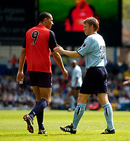 Photo. Jed Wee, Digitalsport<br /> Lucas Radebe Testimonial, Leeds United XI v International XI, 02/05/2005.<br /> Gunnar Halle (R) has a pat on the back for John Carew