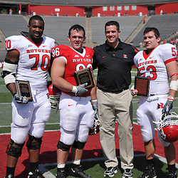 Apr 18, 2009; Piscataway, NJ, USA; Rutgers spring award winners OL Desmond Wynn (70), DT Charlie Noonan (96), and LB Jim Dumont (53) with Athletic Director Tim Pernetti during halftime of Rutgers' Scarlet and White spring football scrimmage.