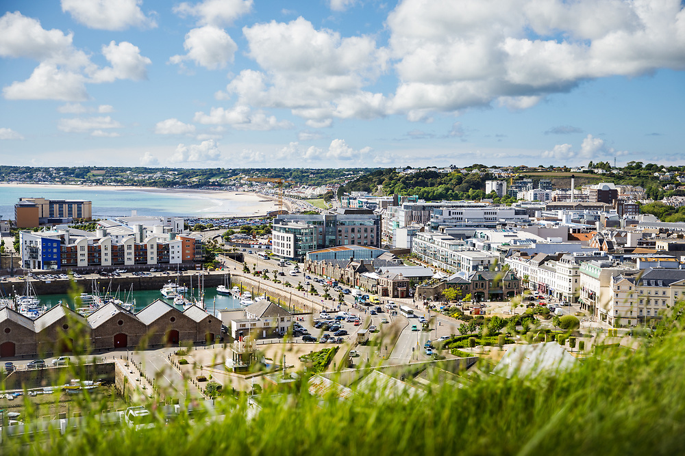 Busy roads, corporate offices and commercial buildings along the waterfront of St Helier, Jersey