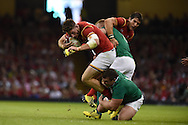 Alex Cuthbert  of Wales is tackled by Ireland's Jack McGrath.. Wales v Ireland rugby union international, RWC warm up friendly match at the Millennium Stadium in Cardiff, South Wales on Saturday 8th August  2015.<br /> pic by Andrew Orchard, Andrew Orchard sports photography.