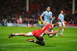 Gloucester Winger (#14) Jonny May crosses to score but the try is disallowed for a forward pass during the second half of the match - Photo mandatory by-line: Rogan Thomson/JMP - Tel: 07966 386802 - 12/10/2013 - SPORT - RUGBY UNION - Kingsholm Stadium, Gloucester - Gloucester Rugby v USA Perpignan - Heineken Cup Round 1.