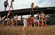 Young girls enjoy the beach on the seafront at Southend, on 29th July 2002, in Southend-on-Sea, Essex, England.