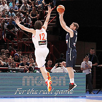 15 July 2012: Fabien Causeur of Team France takes a jumpshot over Sergio Llull during a pre-Olympic exhibition game won 75-70 by Spain over France, at the Palais Omnisports de Paris Bercy, in Paris, France.