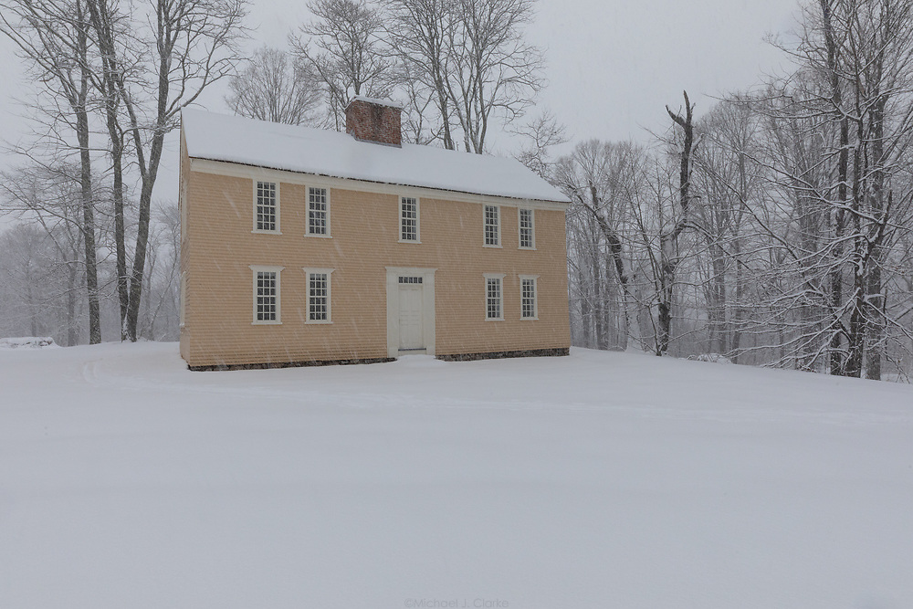 The Job Brooks House in Concord seen during a wintertime blizzard.
