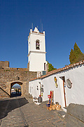 Whitewashed tower and gateway to historic walled hilltop village Monsaraz, Alto Alentejo, Portugal, southern Europe