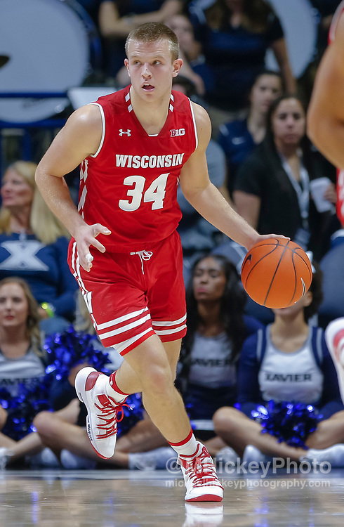 CINCINNATI, OH - NOVEMBER 13: Brad Davison #34 of the Wisconsin Badgers brings the ball up court during the game against the Xavier Musketeers at Cintas Center on November 13, 2018 in Cincinnati, Ohio. (Photo by Michael Hickey/Getty Images) *** Local Caption *** Brad Davison