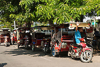 Tuk Tuk Drivers Waiting for Tourists in Phnom Penh, Cambodia
