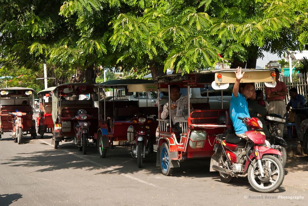 Tuk Tuk Drivers Waiting for Tourists in Phnom Penh, Cambodia